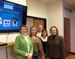 Karen Hendricks, left, leading social media workshops for Adams County Arts Council staff