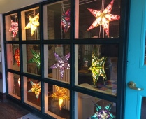 Gorgeous glow... paper stars shine in Lark's front window