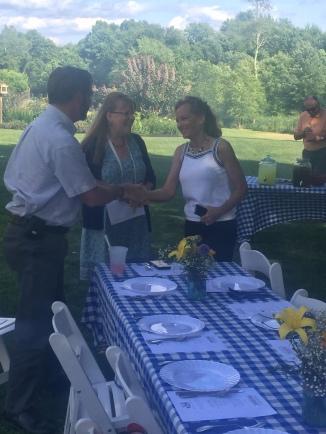 Organizer Lori Korczyk (center) greets guests