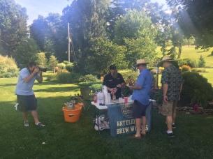 Photographer Casey Martin, left, captures Dan Kulik, Battlefield Brew Works, in action