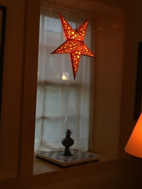 Every window in the living room features a glowing star